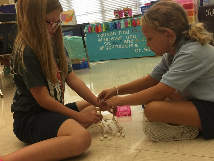Third grade enjoying their team building challenges.