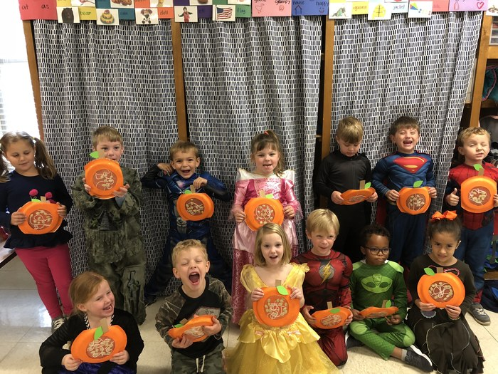 Kindergarten enjoyed learning about and exploring pumpkins this week.