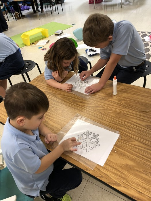 Kindergarten enjoyed making snowflakes with 3rd grade.
