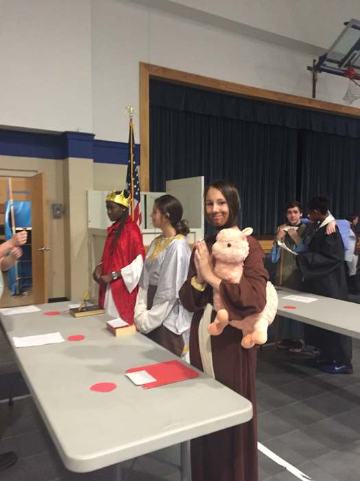 8th grade presented St. Barbara, St. Bernadette Soubirous, and St.  Francis Assisi.