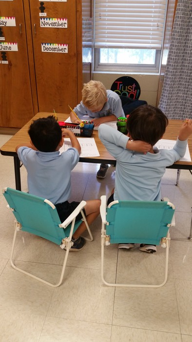 "We are enjoying our new ""seat spots"" in kindergarten!"