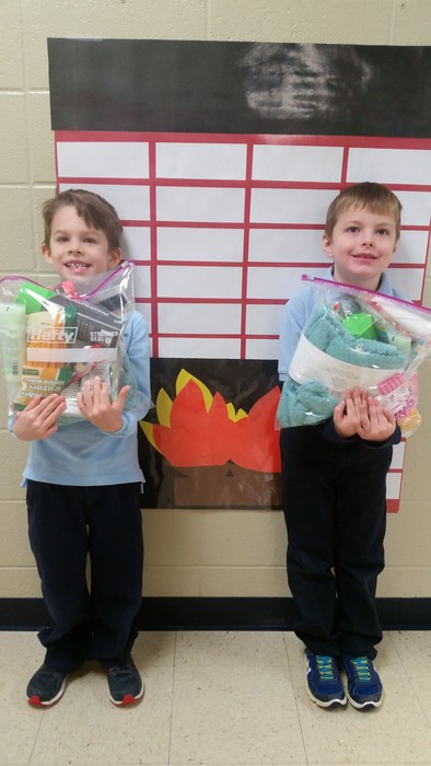 Kindergarten and first grade made blessing bags for the homeless.